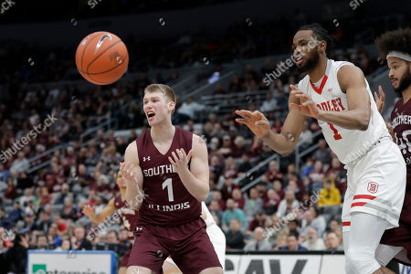 Bradley's Ari Boya, right, passes as Southern Illinois' Marcus Domask reacts during the second half of an NCAA college basketball game in the quarterfinal round of the Missouri Valley Conference men's tournament, in St. Louis