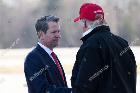 Donald Trump, Brian Kemp. Gov. Brian Kemp, R-Ga., greets President Donald Trump as he steps off Air Force One during arrival, at Dobbins Air Reserve Base in Marietta, Ga