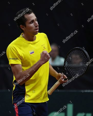 Daniel Galan of Colombia celebrates after defeating Leonardo Mayer of Argentina during their Davis Cup Rakuten Qualifiers tennis match in Bogota, Colombia, Friday, March, 6, 2020. Galan won 6-1, 6-4