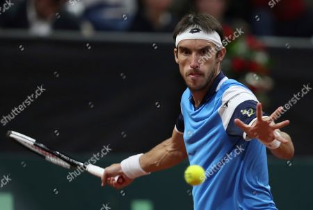 Leonardo Mayer of Argentina returns a ball to Daniel Galan of Colombia during their Davis Cup Rakuten Qualifiers tennis match in Bogota, Colombia, Friday, March, 6, 2020