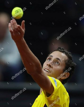 Stock Picture of Daniel Galan of Colombia tosses the ball to serve to Leonardo Mayer of Argentina during their Davis Cup Rakuten qualifiers tennis match in Bogota, Colombia, Friday, March, 6, 2020