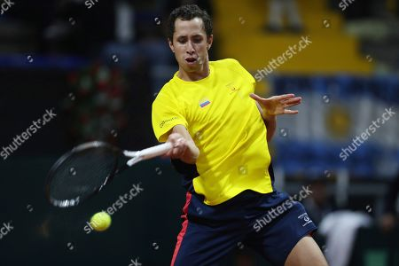 Daniel Galan of Colombia returns a ball to Leonardo Mayer of Argentina during their Davis Cup Rakuten qualifiers tennis match in Bogota, Colombia, Friday, March, 6, 2020
