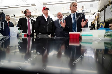 Stock Image of Donald Trump, Robert Redfield, Steve Monroe, Alex Azar. President Donald Trump listens during a meeting with Health and Human Services Secretary Alex Azar, left, Centers for Disease Control and Prevention Director Robert Redfield, and Associate Director for Laboratory Science and Safety Steve Monroe, about the coronavirus at the Centers for Disease Control and Prevention, in Atlanta