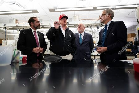 Stock Photo of Donald Trump, Robert Redfield, Steve Monroe, Alex Azar. President Donald Trump speaks during a meeting with Health and Human Services Secretary Alex Azar, left, Centers for Disease Control and Prevention Director Robert Redfield, and Associate Director for Laboratory Science and Safety Steve Monroe, about the coronavirus at the Centers for Disease Control and Prevention, in Atlanta