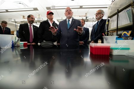 Stock Picture of Donald Trump, Robert Redfield, Steve Monroe, Alex Azar. President Donald Trump speaks during a meeting with Health and Human Services Secretary Alex Azar, left, Centers for Disease Control and Prevention Director Robert Redfield, and Associate Director for Laboratory Science and Safety Steve Monroe, about the coronavirus at the Centers for Disease Control and Prevention, in Atlanta