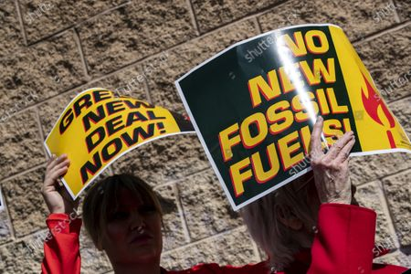 US actress Jane Fonda (L) holds a poster reading 'No New Fossil Fuels' next to a protester holding one reading 'Green New Deal Now' as she participates in a protest in front of a gas depot following a Fire Drill Friday climate change rally in Wilmington, South of Los Angeles, California, USA, 06 March 2020.