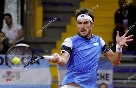Argentinian Leonardo Mayer returns a ball against the Colombian, during a tennis match of the Qualifying Round to the Davis Cup finals 2020 edition, at the Palace of Sports in Bogota, Colombia, 06 March 2020.