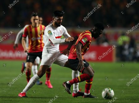 Kwame Bonsu (R) of ES Tunis in action against Ferjani Sassi (C) of Zamalek during the CAF Champions League quarter-final, second leg, soccer match between ES Tunis and Zamalek at the Stade Olympique de Rades in Tunis, Tunisia, on 06 March 2020 (issued 07 March 2020).