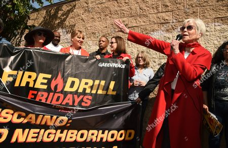 Jane Fonda, right, speaks to Fire Drill Fridays attendees protesting neighborhood oil drilling outside the entrance to an oil field in the Wilmington neighborhood of Los Angeles