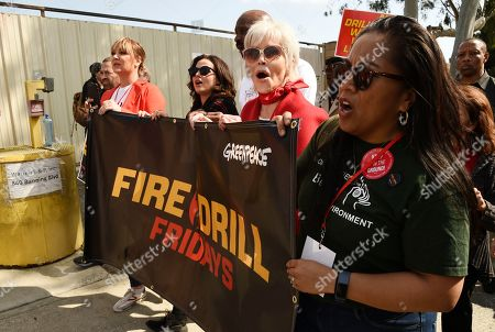 Jane Fonda, second from right, joins Fire Drill Fridays participants protesting neighborhood oil drilling, outside an oil field in the Wilmington neighborhood of Los Angeles