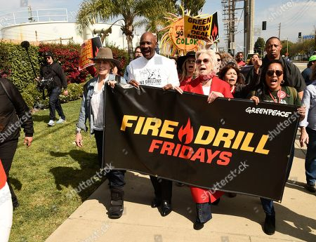 Stock Image of Jane Fonda, Joanna Cassidy, Oliver E. Buie. Actress Jane Fonda, second from right, joins Fire Drill Fridays participants protesting neighborhood oil drilling, outside an oil field in the Wilmington neighborhood of Los Angeles, . At far left is actress Joanna Cassidy and second from left is Rev. Oliver Buie of the Holman United Methodist Church