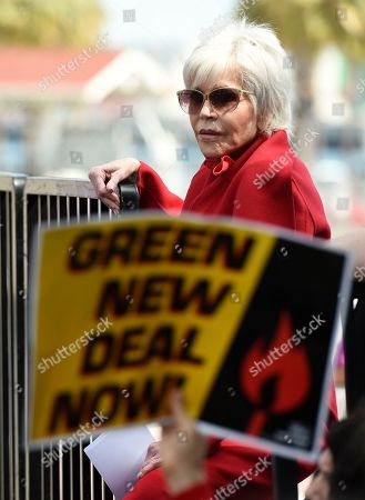 Jane Fonda looks out from the stage during a Fire Drill Fridays rally protesting neighborhood oil drilling, in the Los Angeles Harbor neighborhood