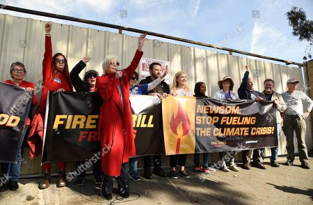 Jane Fonda, left, speaks to Fire Drill Fridays participants blocking the entrance to an oil field in the Wilmington neighborhood of Los Angeles, in Los Angeles