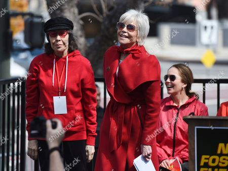 Jane Fonda, Lily Tomlin, Diane Lane. Actress Jane Fonda, center, is joined onstage by fellow actresses Lily Tomlin, left, and Diane Lane during a Fire Drill Fridays rally protesting neighborhood oil drilling, in the Los Angeles Harbor neighborhood