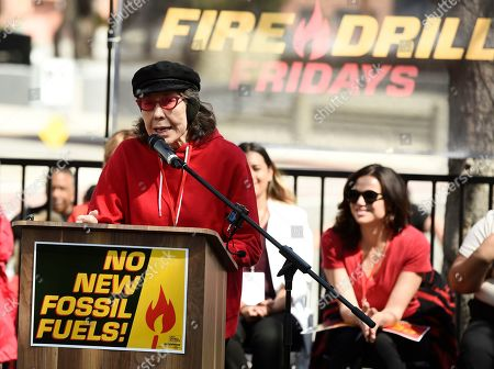 Lily Tomlin addresses the crowd during a Fire Drill Fridays rally protesting neighborhood oil drilling, in the Los Angeles Harbor neighborhood