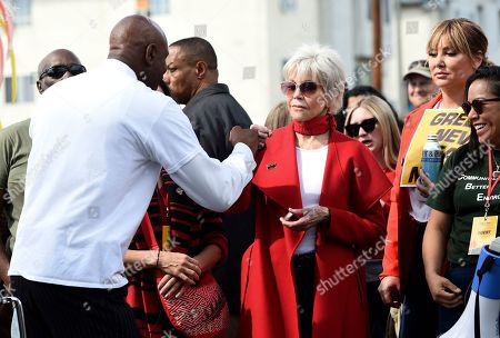 Jane Fonda, Oliver E. Buie. Actress Jane Fonda, right, bumps fists with the Rev. Oliver Buie of Holman United Methodist Church in Los Angeles after he spoke to the crowd at a Fire Drill Fridays rally protesting neighborhood oil drilling, in Los Angeles