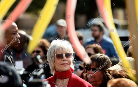 Stock Image of Jane Fonda listens to speakers during a Fire Drill Fridays rally protesting neighborhood oil drilling, in the Wilmington neighborhood of Los Angeles