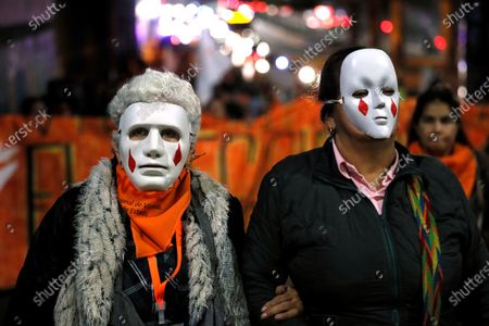 Demonstrators wear masks during a march to mark Day of Dignity for the Victims of State Crimes, in Bogota, Colombia, 06 March 2020.