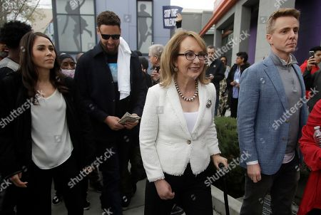 Gabrielle Giffords, Klay Thompson. Former Congresswoman Gabrielle Giffords, center, walks with Golden State Warriors' Klay Thompson, second from left, during a peace march, in Oakland, Calif. Giffords and Thompson participated in 'Building Peace in Oakland and Beyond', a multi-part event to showcase the impact of Oakland's lifesaving gun violence reduction programs and look at opportunities to expand the successes seen in the Bay Area community