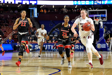 Elysa Wesolek, Ari Henderson, Malury Bates. South Carolina's Elysa Wesolek, right, drives while defended by Georgia's Ari Henderson, center, and Malury Bates during a quarterfinal match at the Southeastern women's NCAA college basketball tournament in Greenville, S.C
