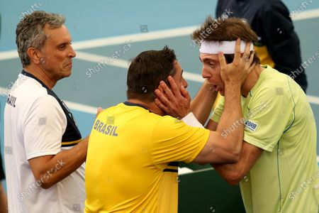 Marcelo Demoliner (R) of Brazil celebrates his win over James Duckworth and John Peers of Australia during the Davis Cup Qualifier between Australia and Brazil at Memorial Drive Tennis Centre in Adelaide, Australia, 07 March 2020.