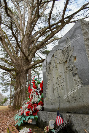 Wreaths and mementos adorn the grave of Jimmie Lee Jackson at Heard Cemetery in Marion, Ala