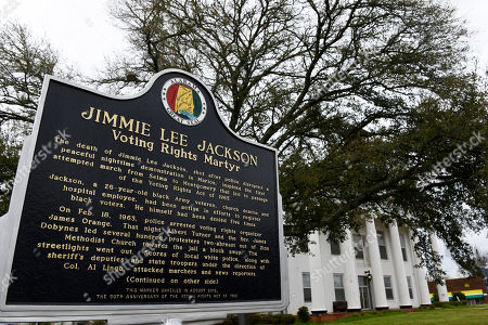 This, photo shows a historic marker honoring civil rights martyr Jimmie Lee Jackson near the Perry County Courthouse in Marion, Ala