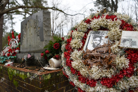 Wreaths and mementos adorn the grave of civil rights martyr Jimmie Lee Jackson at Heard Cemetery in Marion, Ala