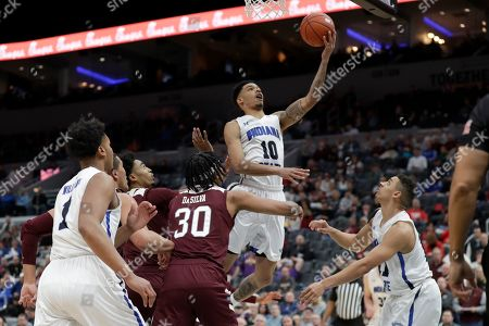 Indiana State's Christian Williams (10) heads to the basket during the first half of an NCAA college basketball game against Missouri State in the quarterfinal round of the Missouri Valley Conference men's tournament, in St. Louis