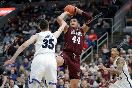 Stock Image of Missouri State's Gaige Prim (44) shoots as Indiana State's Jake LaRavia (35) and Christian Williams, right, defend during the second half of an NCAA college basketball game in the quarterfinal round of the Missouri Valley Conference men's tournament, in St. Louis