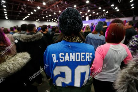 A supporter wears a former Detroit Lions running back Barry Sanders jersey at a campaign rally for Democratic presidential candidate Sen. Bernie Sanders, I-Vt., in Detroit
