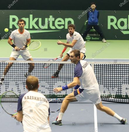 Robin Haase (rear, R) and Jean-Julien Royer  (rear, L) of the Netherlands face Aleksandr Nedovyesov (front, R) and Andrey Golubev (front, L) of Kazakhstan during the Davis Cup qualification between Kazakhstan and The Netherlands at the National Tennis Centre in Astana, Kazakhstan, 07 March 2020.