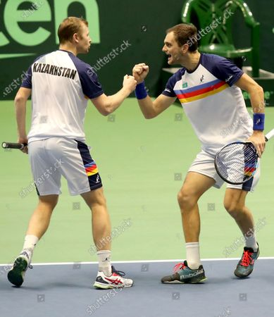 Aleksandr Nedovyesov (R) and Andrey Golubev (L) of Kazakhstan celebrate after winning a point during the Davis Cup qualification between Kazakhstan and The Netherlands at the National Tennis Centre in Astana, Kazakhstan, 07 March 2020.