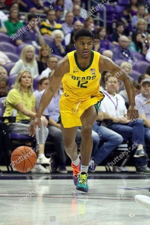 Baylor guard Jared Butler (12) drives the ball against TCU during an NCAA college basketball game on in Fort Worth, TX