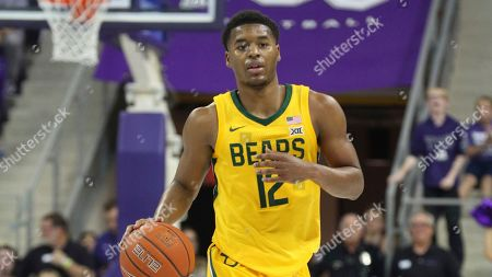 Stock Photo of Baylor guard Jared Butler (12) brings the ball down court against TCU during an NCAA college basketball game on in Fort Worth, Texas