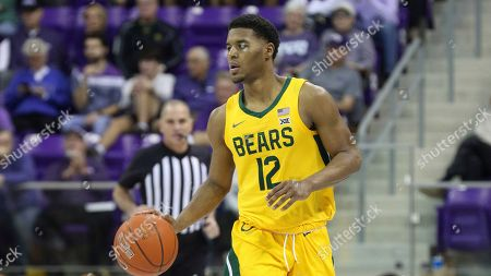 Baylor guard Jared Butler (12) brings the ball down court against TCU during an NCAA college basketball game on in Fort Worth, Texas
