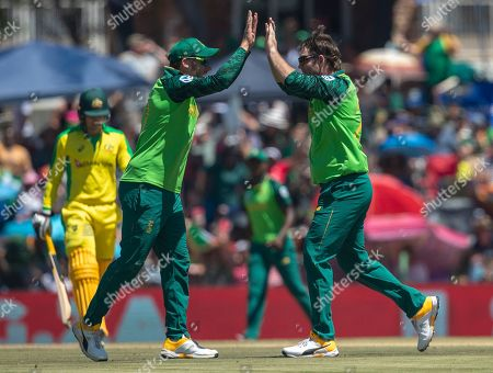 South Africa's bowler Jon Jon Smuts, right, celebrates with teammate David Miller, after bowling Australia's batsman Alex Carey for a duck on during the 3rd and final One Day International cricket match between South Africa and Australia at Senwes Park, Potchefstroom, South Africa