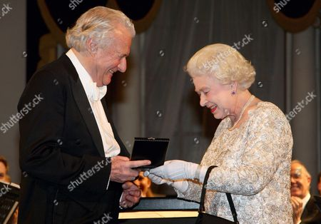Queen Elizabeth II presents the Queen's Medal for Music to conductor Sir Colin Davis