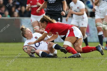 Stock Picture of Emily Scott of England is tackled by Kerin Lake of Wales