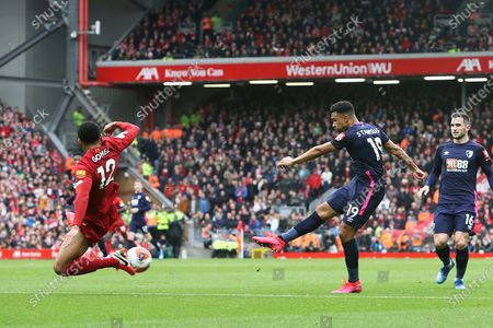 Liverpool defender Joe Gomez (12) tries to block the shot from Bournemouth midfielder Junior Stanislas (19) during the Premier League match between Liverpool and Bournemouth at Anfield, Liverpool