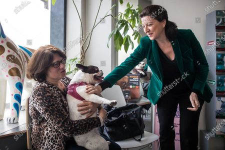 Former French Health Minister and mayoral candidate for Paris Agnes Buzyn (R) meets a dog and its owner during a visit at a veterinary clinic as part of her campaign in Paris, France, 07 March 2020. Buzyn took the candidacy for the 'La Republique En Marche' (LREM) party, replacing former candidat Benjamin Griveaux who dropped his candidacy in the Paris municipal elections on 14 February over publication of sexual imagery allegedly related to him on social media.