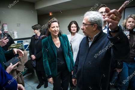 Former French Health Minister and mayoral candidate for Paris Agnes Buzyn (C-L) visits a veterinary clinic as part of her campaign in Paris, France, 07 March 2020. Buzyn took the candidacy for the 'La Republique En Marche' (LREM) party, replacing former candidat Benjamin Griveaux who dropped his candidacy in the Paris municipal elections on 14 February over publication of sexual imagery allegedly related to him on social media. Others are not identified.