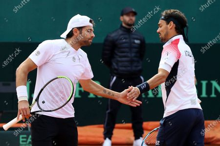 Stock Photo of Fabio Fognini (R) and Simone Bolelli of Italy react during their match against South Korea's Ji Sung Nam and Min-Kyu Song at the Davis Cup qualifier between Italy and South Korea in Cagliari, Italy, 07 March 2020.