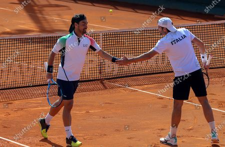 Fabio Fognini (L) and Simone Bolelli of Italy react during their match against South Korea's Ji Sung Nam and Min-Kyu Song at the Davis Cup qualifier between Italy and South Korea in Cagliari, Italy, 07 March 2020.