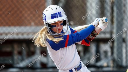 Stock Photo of UMass Lowell's Christina Rizzi connects for a hit during an NCAA softball game against Purdue Fort Wayne, in Clarksville, Tenn
