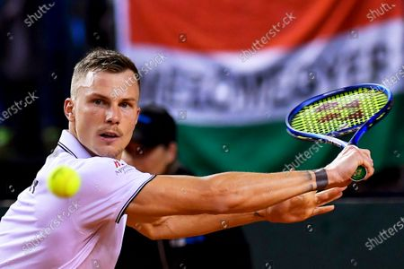 Marton Fucsovics of Hungary in action against Ruben Bemelmans of Belgium at the Davis Cup qualifier between Hungary and Belgium in Debrecen, Hungary, 07 March 2020.