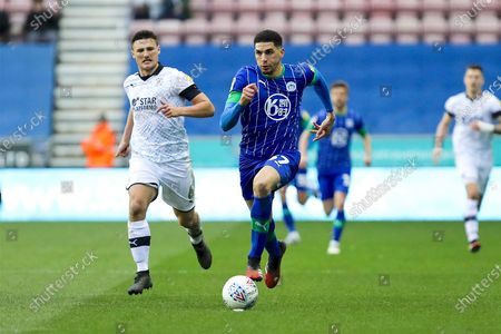Wigan Athletic defender Leon Balogun in possession of the ball  during the EFL Sky Bet Championship match between Wigan Athletic and Luton Town at the DW Stadium, Wigan