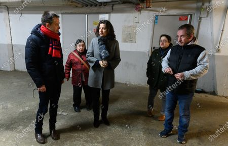 Pierre-Yves Bournazel (L) and Agnes Buzyn (C) visiting a cellar.  Agnes Buzyn of the ruling La Republique en Marche (LREM) meets with a tenants' association and will take the opportunity to present her housing priorities in the capital.