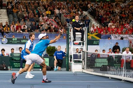 Ariel Behar (L) and Pablo Cuevas (R) of Uruguay in action against Oliver Marach and Juergen Melzer of Austria during their doubles match of the Davis Cup qualifier between Austria and Uruguay in Premstaetten, near Graz, Austria, 07 March 2020.