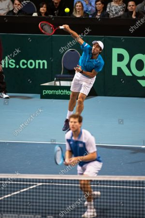 Ariel Behar (front) and Pablo Cuevas (back) of Uruguay in action against Oliver Marach and Juergen Melzer of Austria during their doubles match of the Davis Cup qualifier between Austria and Uruguay in Premstaetten, near Graz, Austria, 07 March 2020.